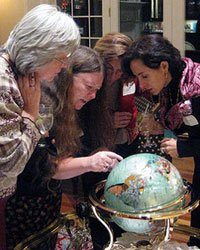 AAPLAC Annual Conference attendees examining a globe. Photo courtesy of Natalia Porto.